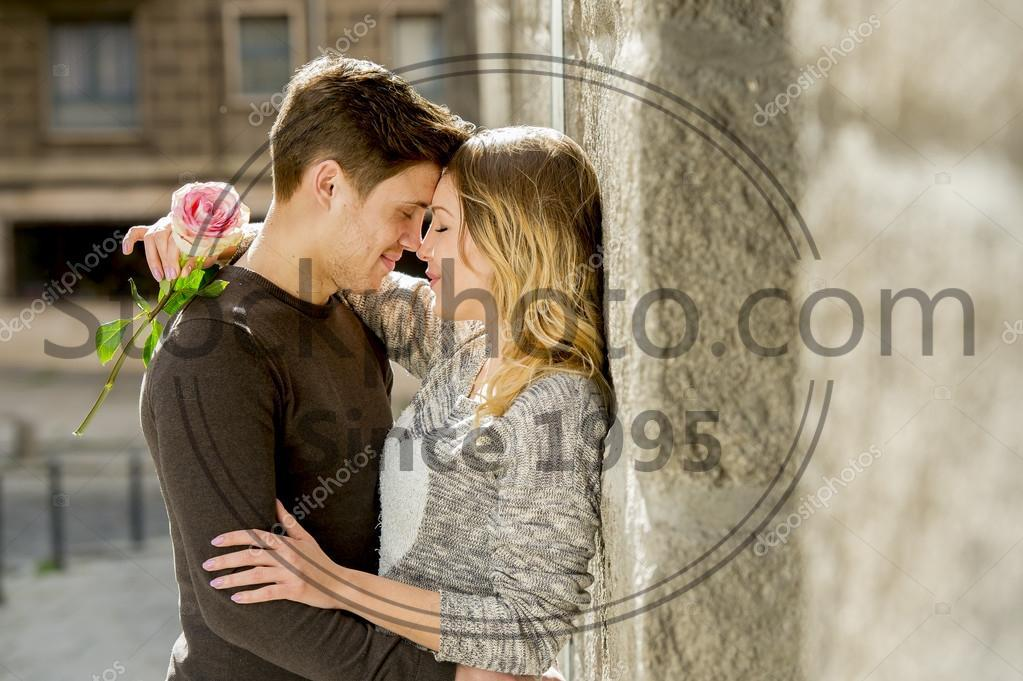 Stock photos beautiful couple in love kissing on street alley stock photo of beautiful couple in love kissing on street alley celebrating valentines day candid thecheapjerseys Image collections
