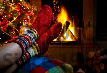 stock photo of romantic winter evening by the fireplace christmas and christmas tree romantic winter
