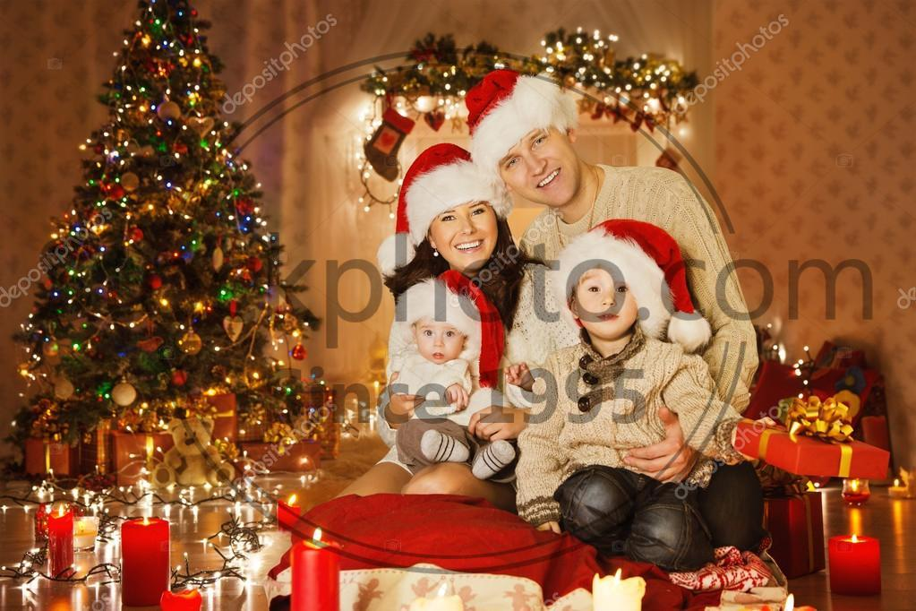 Christmas Family Portraits.Christmas Family Portrait In Home Holiday Living Room Kids And Baby At Santa Hat With Present Gift Box House Decorating By Xmas Tree Candles Garland