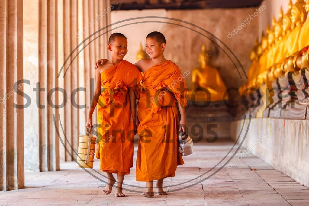 Stock photo of Two novices walking and talking in old temple at Ayutthaya Province, Thailand - Two novices walking and talking in old temple at Ayutthaya Province, Thailand