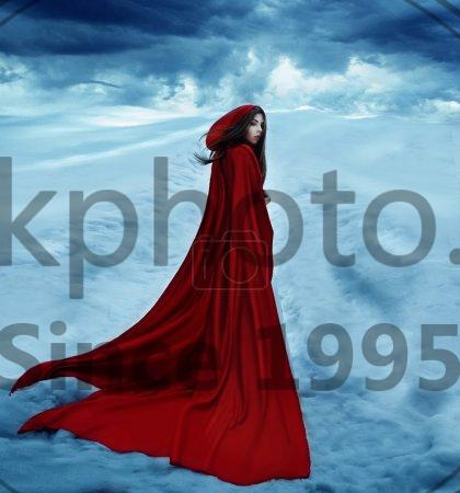 Stock photo of Red Riding Hood -  Little Red Riding Hood is going away on a snowy road and clouds. Dramatic and fantastic shooting,fashionable toning, creative computer colors