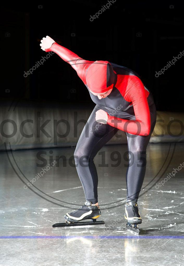 Stock photo of Speed skating start - Speed skater at the starting line of a long distance race on an indoor ice rink