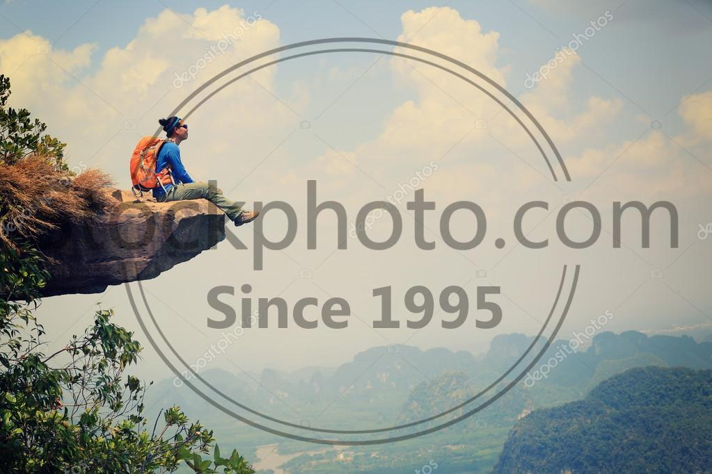 Stock photo of successful woman hiker - Successful woman hiker enjoy the view on mountain top