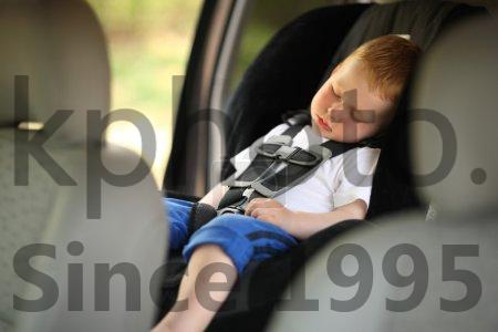Stock photo of Boy sleeping in child car seat - Boy sleeping in child car seat. Shallow DOF.