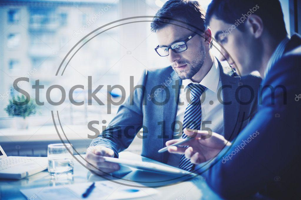 Stock photo of Networking - Image of two young businessmen discussing project at meeting