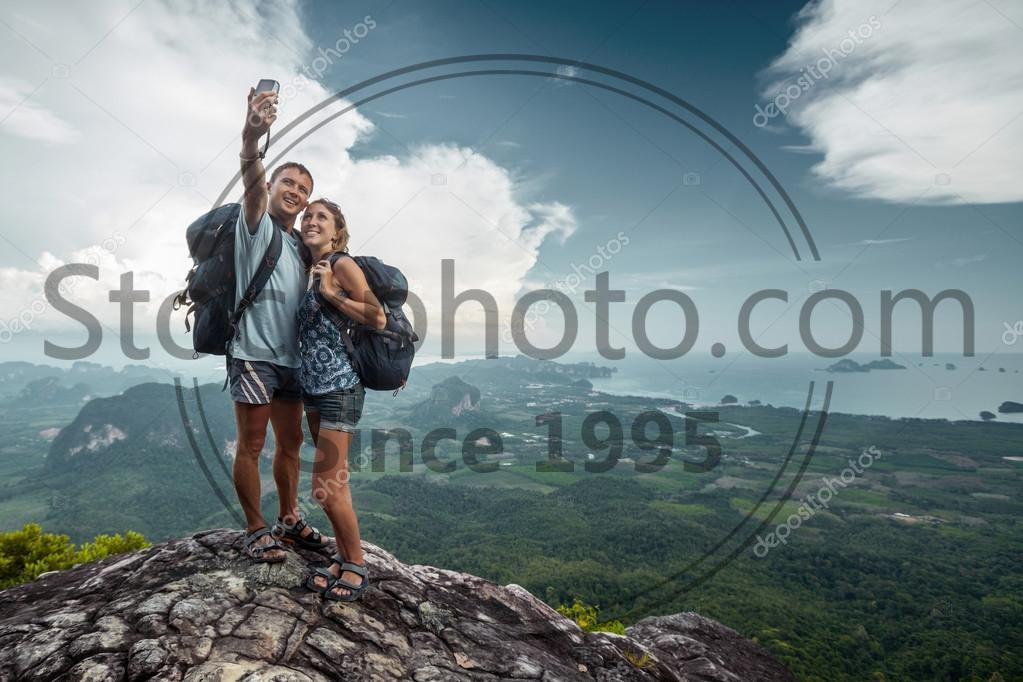 Stock photo of Hiker - Two hikers taking selfie on top of the mountain