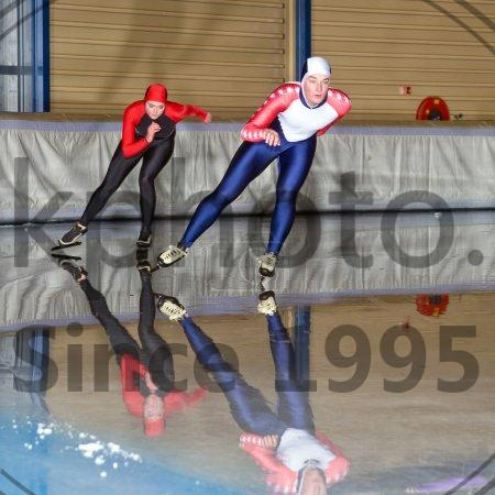 Stock photo of Speed Skating Race - Speed skaters during a race in an indoors ice rink