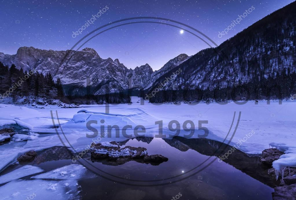 Stock photo of Beautiful night at the frozen lake  - Beautiful night at the frozen lake in Italy at Laghi di Fusine