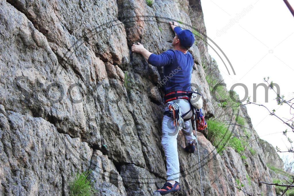 Stock photo of Rock climber on route - Young Rock climber on route