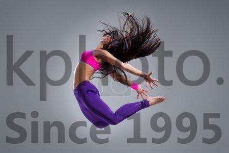 Stock photo of The dancer - Modern dancer poses in front of the studio background