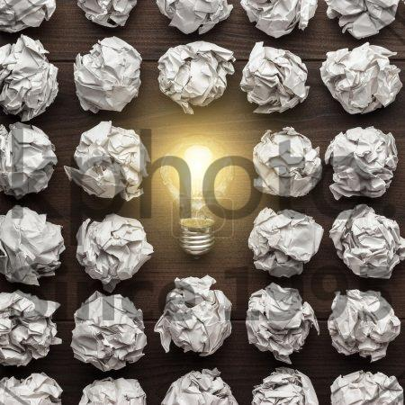 Stock photo of excellent idea concept - New idea concept with crumpled office paper and light bulb