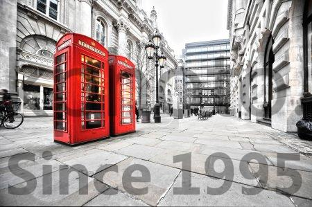 Stock photo of Booths - Two red phone booths on the street