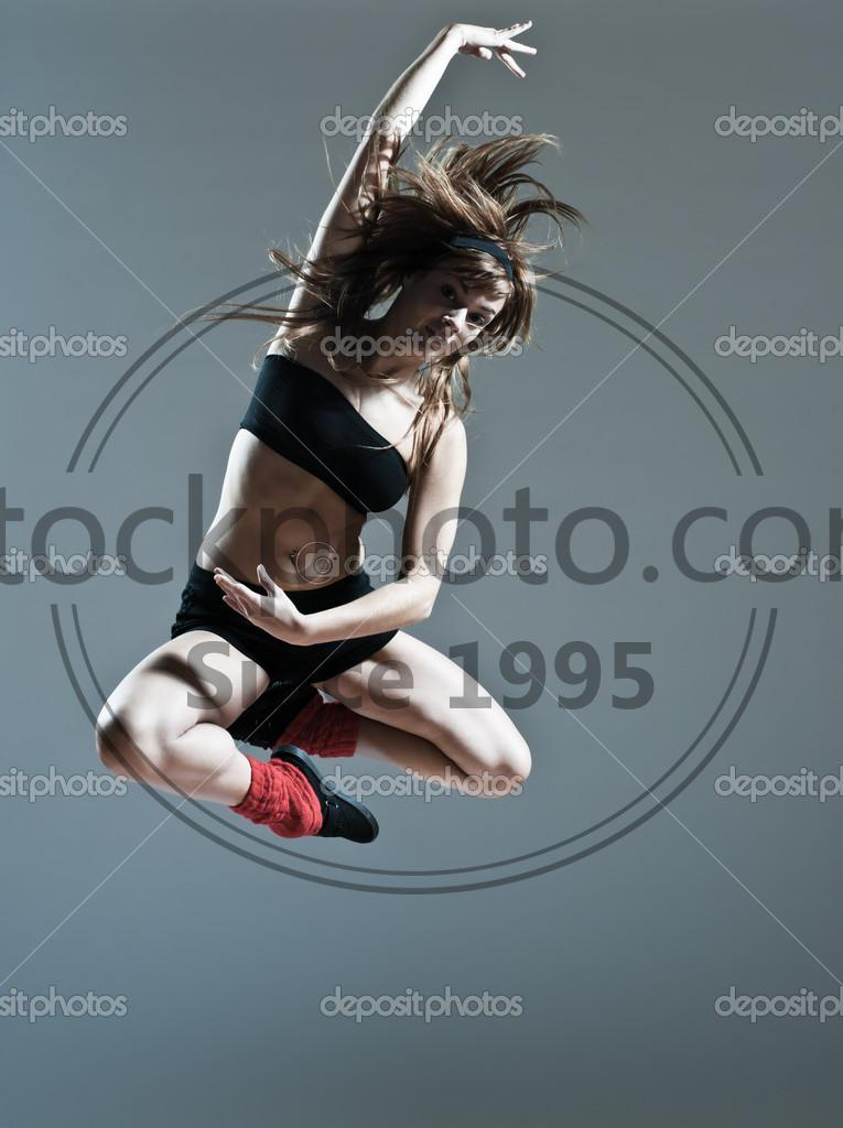 Stock photo of Beautiful young woman leap jump - Beautiful young caucasian woman girl dancer ballet breakdance leap jump on studio isolated background