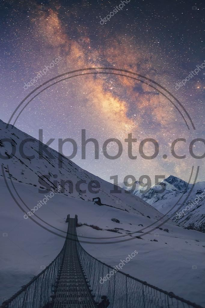 Stock photo of Bridge to the sky - Milky way under the snowy mountains in the night. Gangapurna (7,455 m) and Annapurna III (7,555 m) on the background.