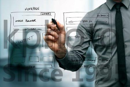 Stock photo of Designer drawing website development wireframe - Designer drawing website development wireframe