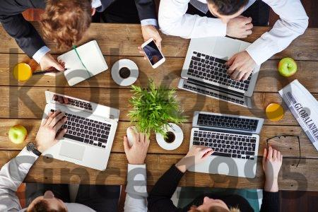 Stock photo of Business people using modern gadgets - Top view of group of business people using modern gadgets at workplace