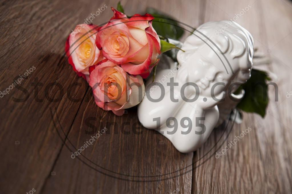 Stock photo of Angel with flowers. Concept - Angel with flowers. Valentines day concept