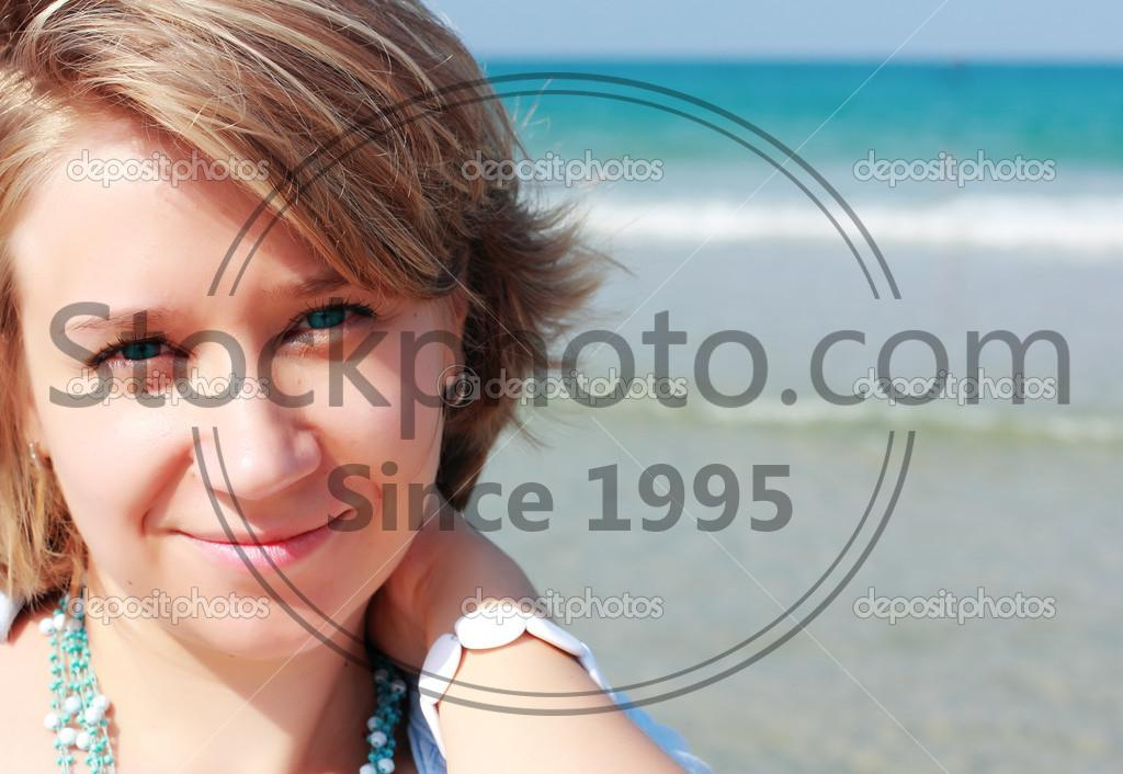 Stock photo of Portrait of beautiful young woman on the beach - Portrait of beautiful young woman on the beach