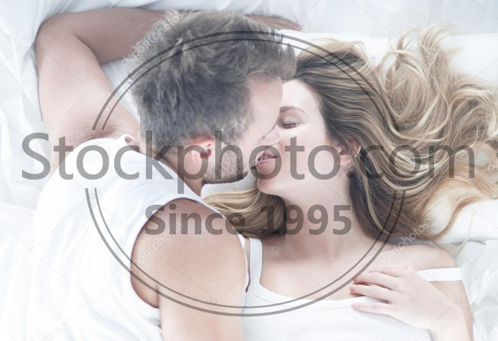 Stock photo of Just married couple - Just married and romantic kiss in the morning