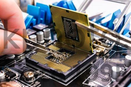 Stock photo of Computer repair - Repair computer components with tools, close up view