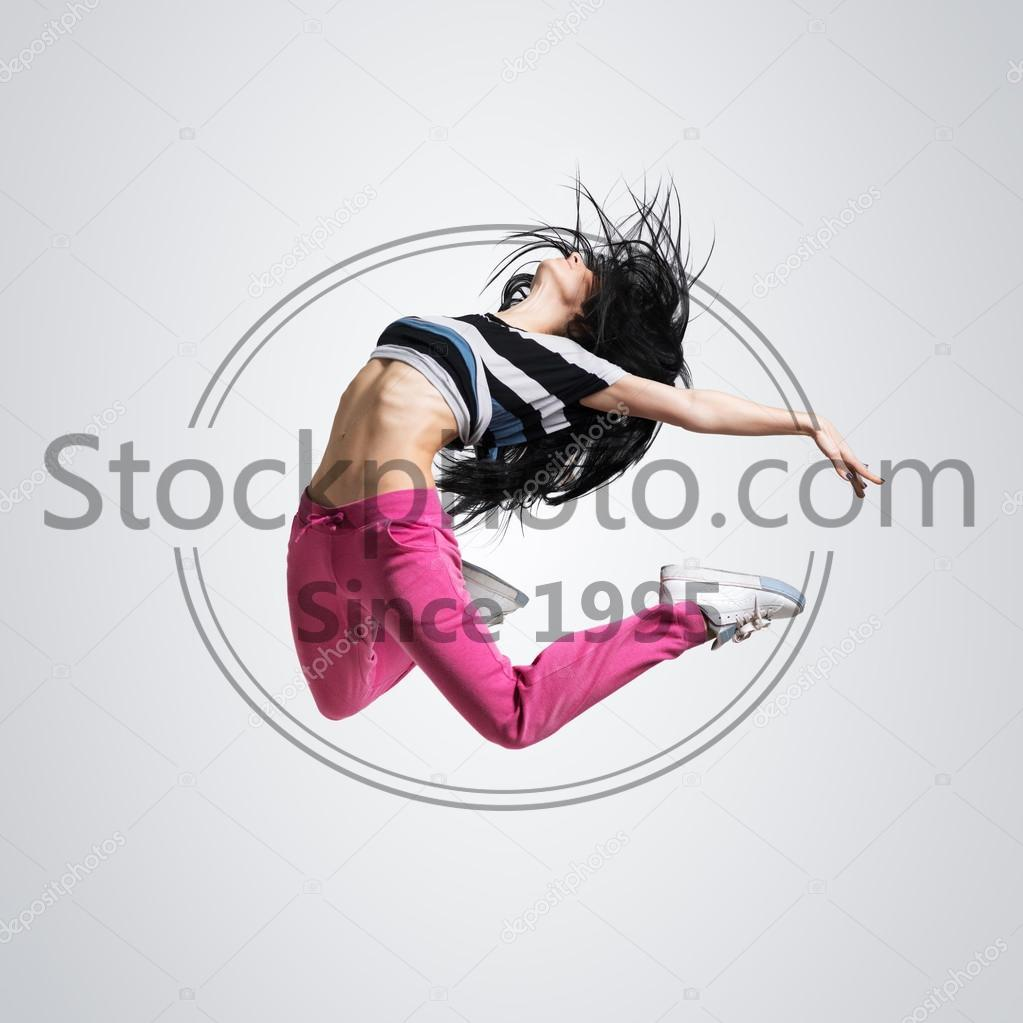 Stock photo of athletic girl dancing jumping - Beautiful athletic girl dancing jumping