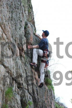 Stock photo of Rock climber on route - Rock climber on route